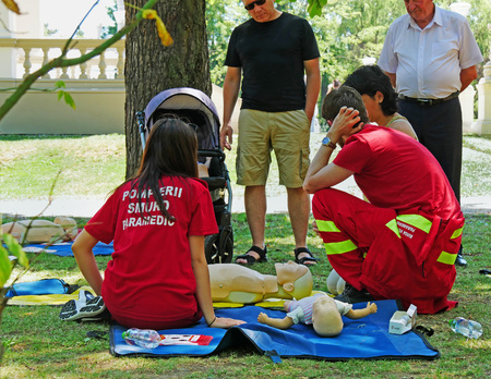 Paramedics are teaching people how to perform CPR on manikins in the park in Cluj-Napoca, Romania - June 9, 2017 Editöryel