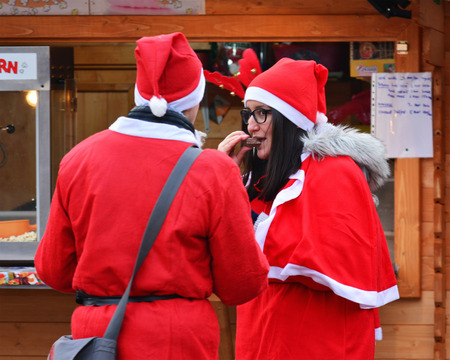 CLUJ-NAPOCA, ROMANIA - DECEMBER 17, 2016:  Young people dressed in Santa Claus costumes on the street Editorial