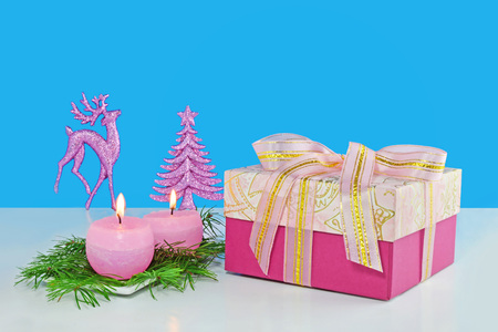 Christmas background, greeting card with two burning candles, decorations, gift and fir branches Standard-Bild - 91361064