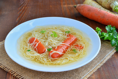 Bouillon clear beef or chicken broth with noodles and vegetables