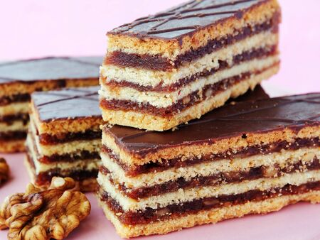 Hungarian Gerbeaud layered cake with walnut and apricot jam filling, covered with chocolate (zserbo szelet) Stock fotó