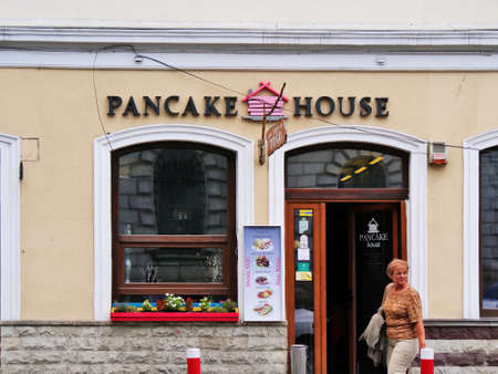 Cluj-Napoca, Romania - July 16, 2019: Open door of Pancake house bistro selling assortments of pancakes and salads. Freanch pancakes and American pancakes to go.