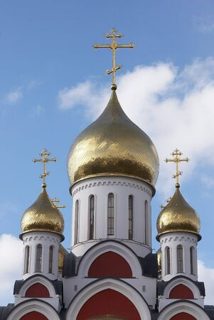 Close up of a Christian temple with the gilt domes