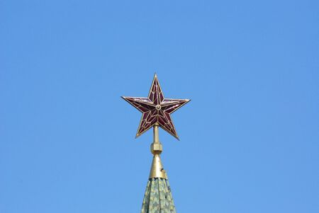 Ruby star on a tower spike in the clear afternoon Stock Photo