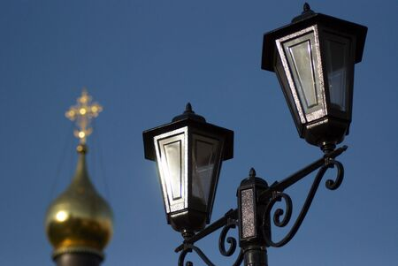 Close up of a street lantern on a background a gold dome of church Stock Photo
