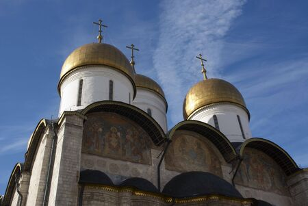 Kind on church with three domes located in territory kremlin
