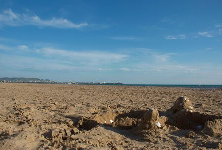 View of the sea the foreground a sandy beach a background a resort city anapa against mountains