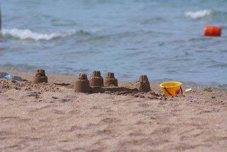 Fortress from sand constructed by children on a beach
