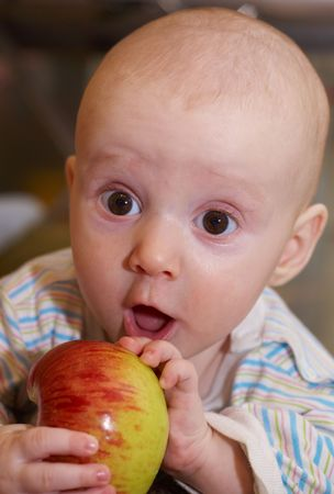 Close up of the kid with an apple in hands Stock Photo