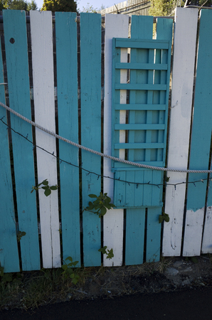 lattice window: Teal and white fence