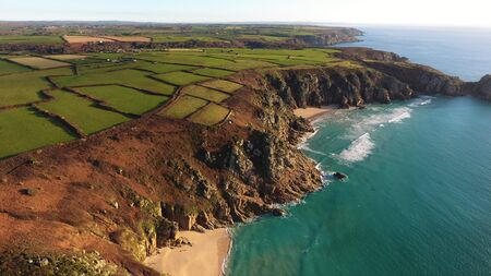 Beautiful coastline from above in Porthcurno, Cornwall, England Imagens