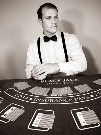 Croupier deals cards at game blackjack table