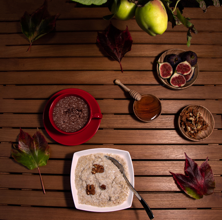 Autumn breakfast of porridge, oats, and fruit