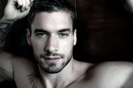 Portrait of good looking shirtless man looking at camera Archivio Fotografico