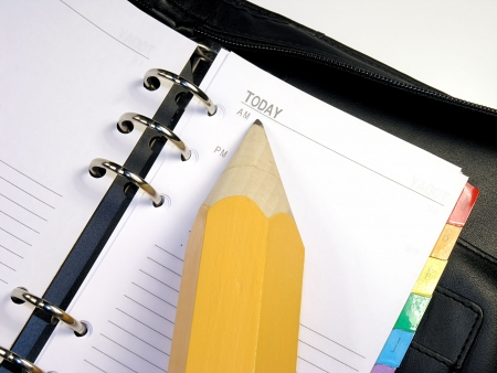 Day planner with a huge pencil pointing to Today. Stock Photo
