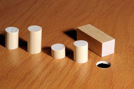 round: Square peg and a round hole.  Metaphor for a misfit or nonconformist.