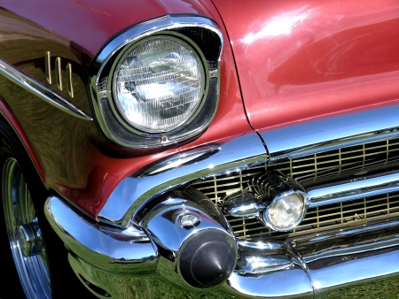 Closeup of the right front headlight and fender detail of a classic . photo
