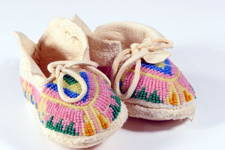 native american baby: Babys beaded Indian moccasins. Stock Photo