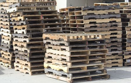 on the skids: Stacks of wooden pallets (skids).