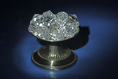 lavish: Diamonds highlighted on a pedestal with a blue and black background. Stock Photo