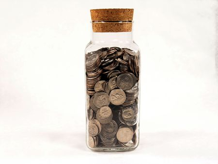 dime: Glass jar filled with coins Stock Photo