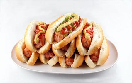 Plate of stacked hotdogs.  Ketchup, mustard, and relish. Stock Photo
