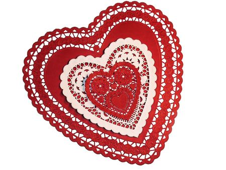 sweetest: Three paper hearts of different sizes. Two red and one white. On a white background. Stock Photo