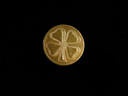 four leaf: El tr�bol de cuatro hojas moneda.