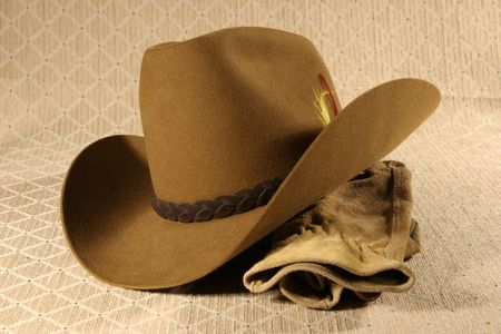 stetson: Cowboy hat and leather work gloves.