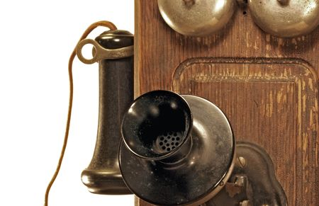 Closeup of an antique crank telephone.