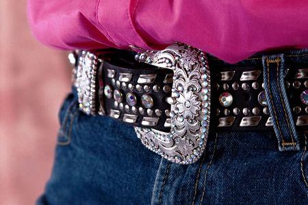 Closeup of a western belt.  Silver buckle and rhinestones.