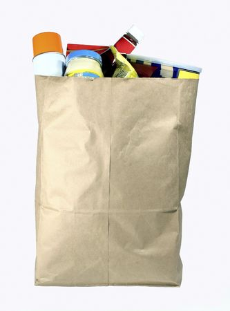 aerosol can: Paper sack full of groceries.  Isolated on white.