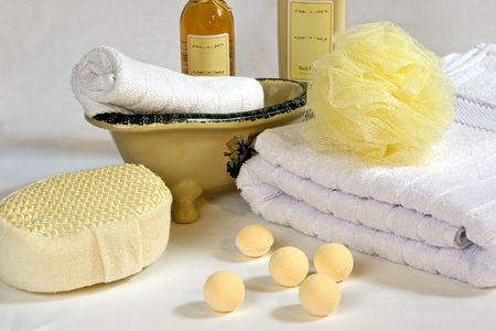 Various bath accessories including a body sponge, loofa, towel, lotion, oil, etc. Stock Photo