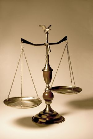 justice balance: Decorative scale  balance with wooden accents and an eagle on top.  Bronze background.