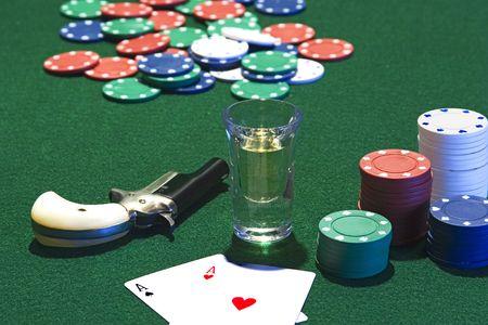 dealt: Poker game.  Poker chips, shotglass, and derringer on the table.