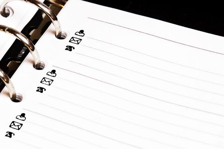dayplanner: Dayplanner open to a blank CONTACTS page. Stock Photo