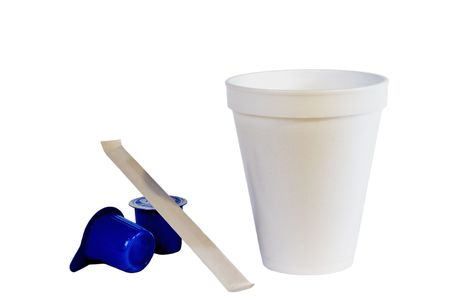 Styrofoam coffe cup, creamers, and stir stick isolated on white. Stock Photo