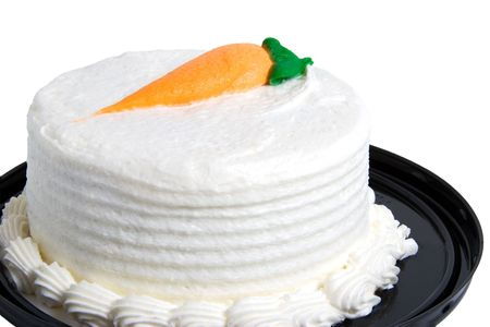 Personal size carrot cake.  White icing with a carrot made of orange and green icing on top. Stock Photo