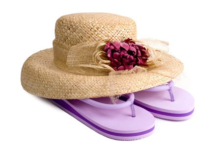 Ladies straw hat with flower decoration and purple flip-flops.