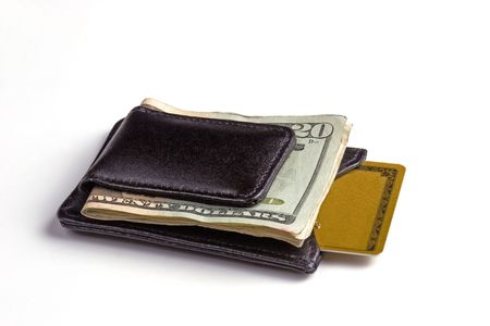 Black leather money clip with a credit card pocket.  Twenty dollar bill on top with a credit card sticking out of the wallet. photo