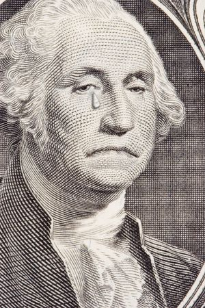 george washington: Closeup of a saddened George Washington on the one dollar bill.  George has a tear streaming down the right cheek.  Metaphor for the poor performance of the US Dollar.