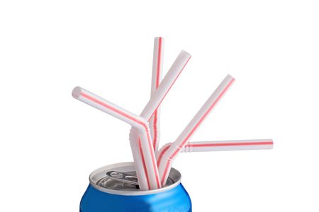 Pop can with five straws sticking out of it.