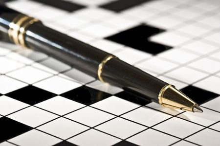 Executive's ballpoint pen on a blank crossword puzzle.  Conceptual image for filling in the blanks, problem solving, brain storming, etc. Stock Photo - 1355014