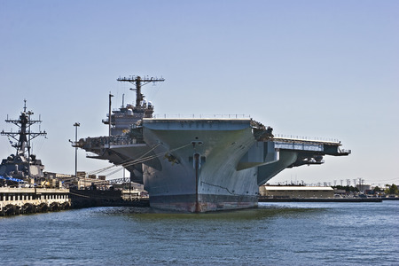 US Navy aircraft carrier docked in Norfolk, Virginia.  The largest and mightiest of all naval ships. Stock Photo - 1526956