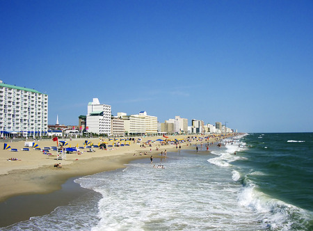 Beach shoreline.  Many people enjoying the sea, sand, and surf of Virginia Beach. Stock Photo