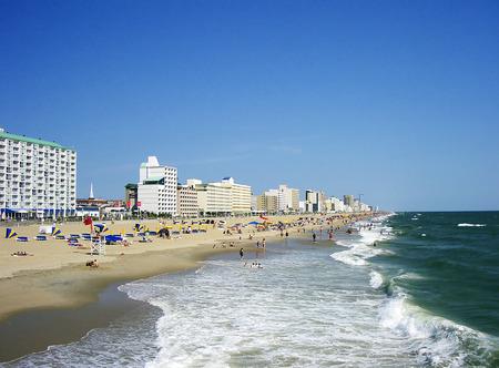 Beach shoreline.  Many people enjoying the sea, sand, and surf of Virginia Beach. Stock Photo