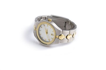 mans watch: Mans gold and silver wrist watch on a white background.