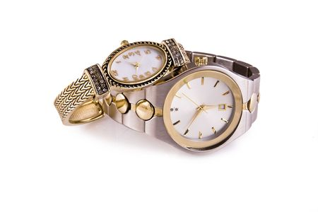 Mens and ladies gold and silver wrist watches on a white background. photo
