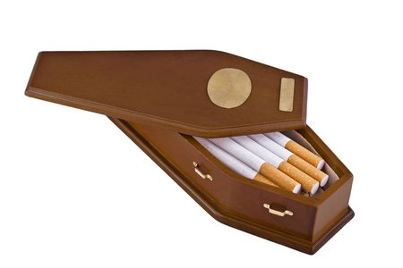 smoker: Wooden coffin containing cigarettes.  This is a conceptual image for the perils of smoking or quitting smoking.  The casket has brass handles and two brass plates, perfect for adding text.