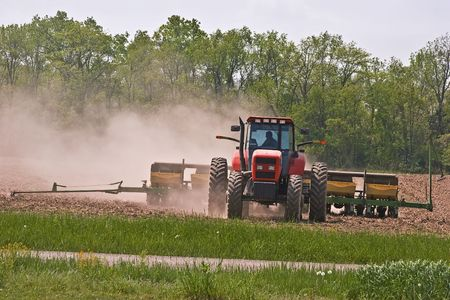Farmer planting corn. Stock Photo